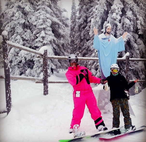 Snowboarding in my pink onezie!